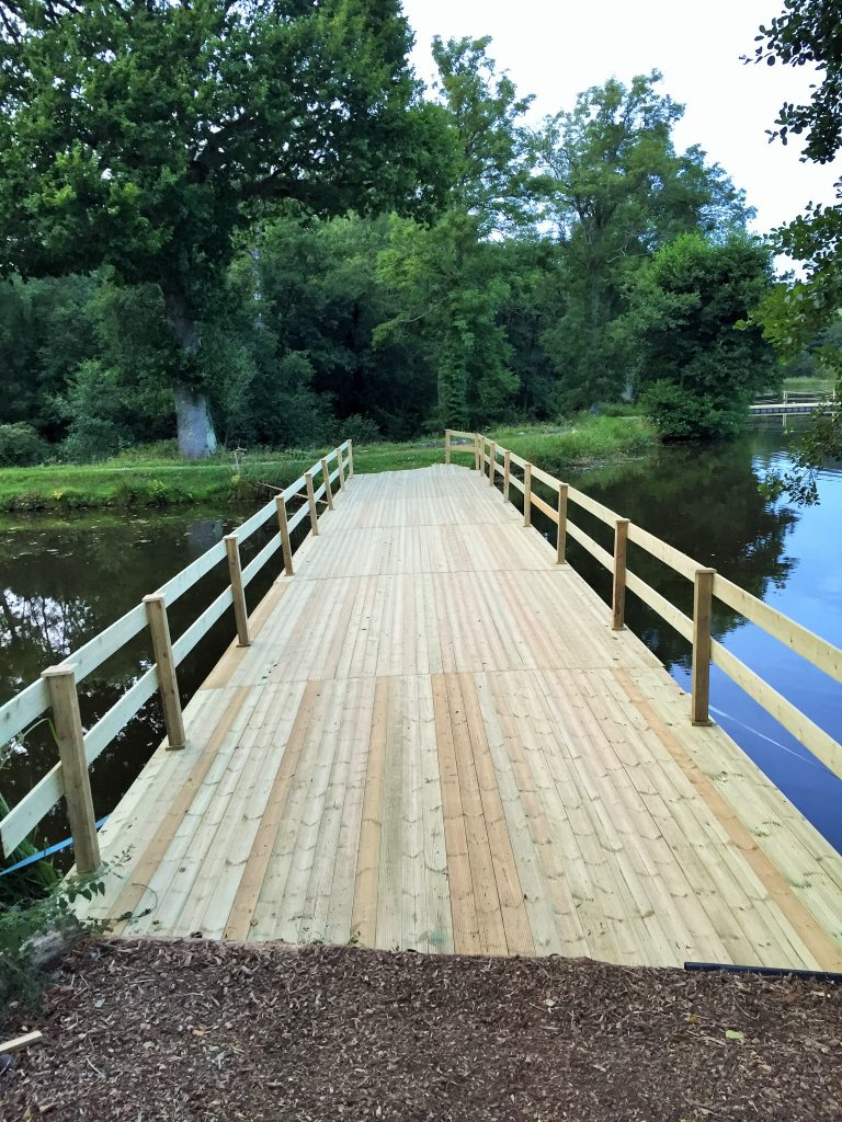 Timber clad pontoon bridge