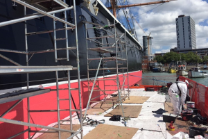 Repainting HMS Warrior using pontoons
